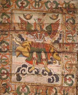 Arcangel con Clavos
