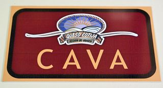 The sign on the cava entrance includes its logo, registered as the