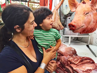 Mom and Baby with Pig Head